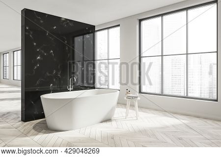 Corner View Of The Panoramic Empty White Interior, Having Wood Tile Floor And The Minimalist Bathroo