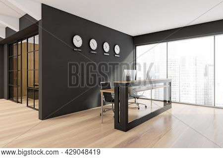 Panoramic Reception With Glass Frontal Part Of Desk, Wooden Floor, Black Wall With Clock, Showing Wo