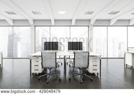 White And Grey Interior Of A Modern Company With Two Office Chairs At Either Side Of The Desk, Concr