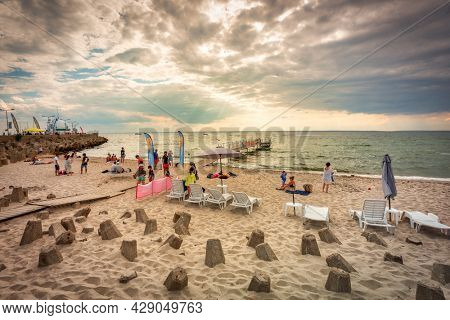 Hel, Poland - July 29, 2021: People on the beach in Hel at the Baltic Sea, Poland