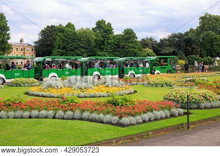 Kew Gardens, London 2021.  A Land Train Transporting Visitors Around The Gardens. The Land Train Run