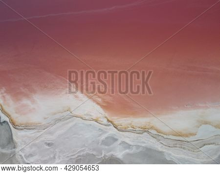 Aerial Top Down Wide Shot Pink Salt Lake. Flying Over The Pink Colored Lagoons Of Salt Fields. Pictu