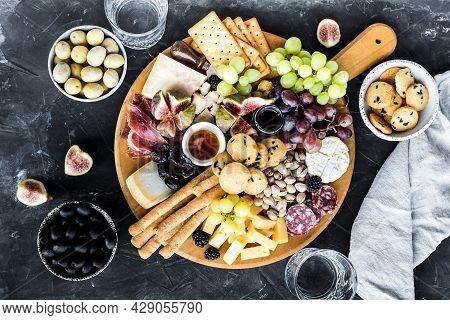 Charcuterie Board. Cheese Platter: Parmesan, Maasdam, Camembert, Cheddar, Gouda With Prosciutto, Sal