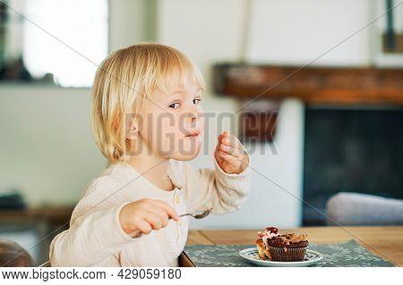 Cute Toddler Boy Eating Cupcakes For Dessert, Sweet Snacks