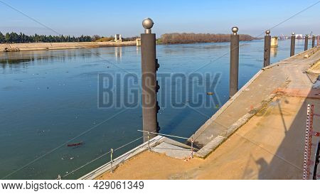 Pillars At River Rhone In Arles Provence France