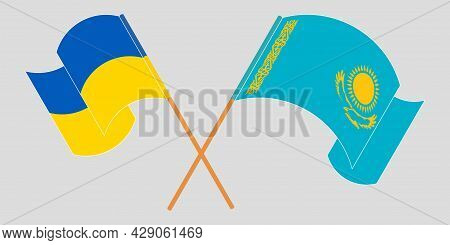 Crossed And Waving Flags Of The Ukraine And Kazakhstan