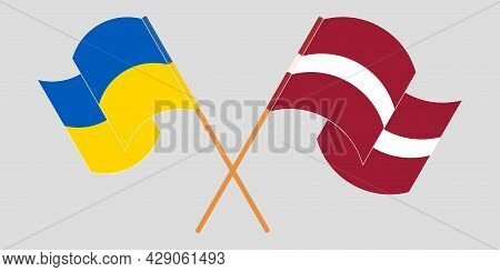 Crossed And Waving Flags Of The Ukraine And Latvia