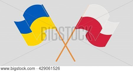 Crossed And Waving Flags Of The Ukraine And Poland