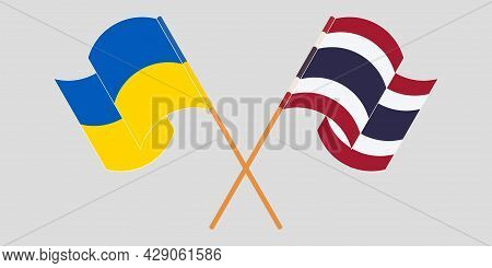 Crossed And Waving Flags Of Ukraine And Thailand