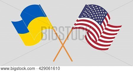Crossed And Waving Flags Of The Ukraine And The Usa