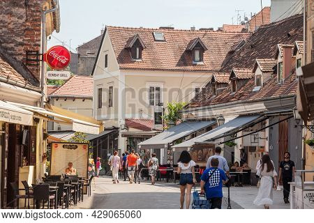 Zagreb, Croatia - June 19, 2021: Ulica Ivana Tkalcica Street With People Passing By Crowded Restaura