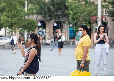 Belgrade, Serbia - July 12, 2021: Indian Tourists, A Couple Of Lovers, Man And Woman, Young, From In