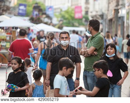 Belgrade, Serbia - July 30, 2021: Indian Tourists, A Father, Male, Surrounded By A Crowd Of Kid, Mal