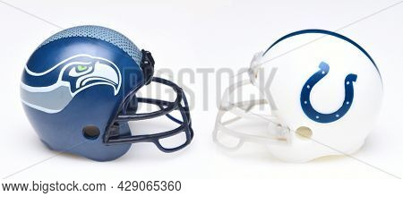 IRVINE, CALIFORNIA - 24 JUNE 2021: Football helmets of the Seattle Seahawks and the Indianapolis Colts, Week One opponents in the NFL 2021 Season