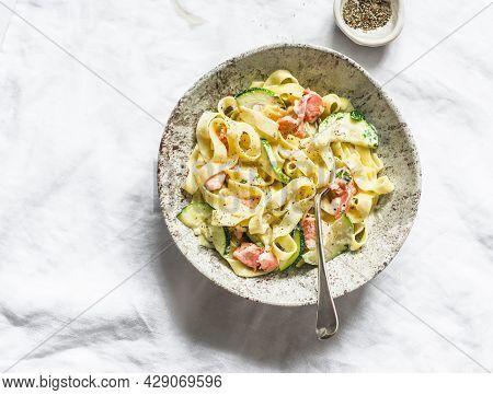 Fresh Homemade Tagliatelle Pasta With Salmon And Zucchini  Cream Sauce On A Light Background, Top Vi
