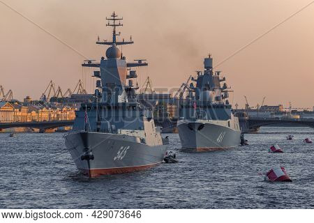 Saint Petersburg, Russia - July 26, 2021: Warships On The Neva On A June Evening. Navy Day In St. Pe