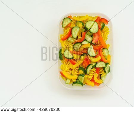 View From Above On Vegan Cold Pasta Salad With Fresh Veggies Cucumber And Bell Peppers In Plastic Co