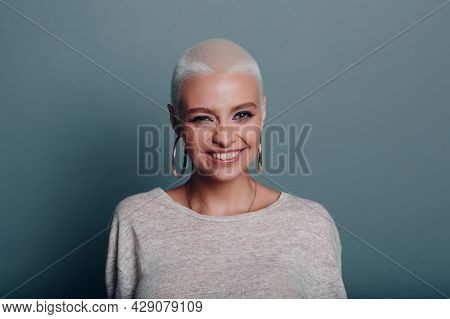 Millenial Young Woman With Short Blonde Hair Winks Smiling Portrait