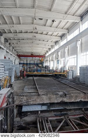 Inside View Of The Workshop For The Production Of Reinforced Concrete. Concrete Beams, Roof And Trus