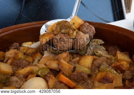 Close-up Of A Stew Of Meat Balls With Mediterranean Vegetables In A Clay Pot. Image Of Mediterranean