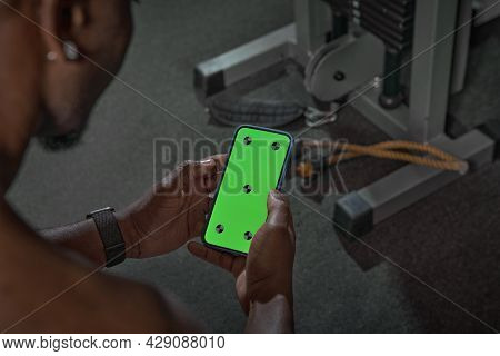 African American Man With Green Screen Phone With Tracking Points. Gym Workout And Sports App For Ex