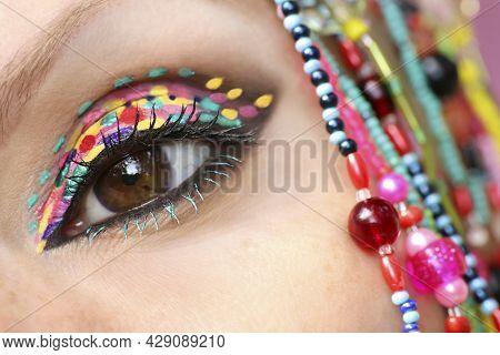 Creative Trendy Spotty Eye Makeup Close Up.