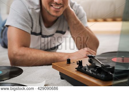 Happy Man Using Turntable At Home, Closeup