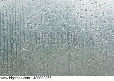 Raindrops And Water Drops On The Surface Of The Clear Film. Raindrops As A Texture.