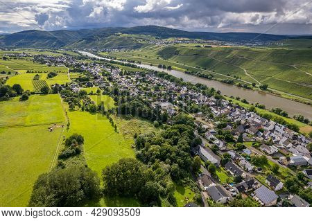 Aerial View Of A Landscape In Rhineland-palatinate, Germany On The River Moselle With The Village Br