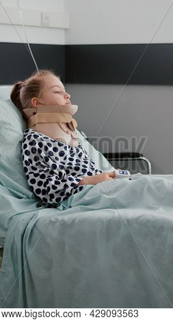 Sick Patient Resting In Bed Wearing Neck Cervical Collar Having Health Injury Recovering After Painf