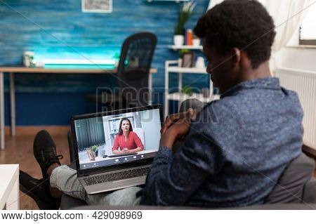 Black Remote Person Working From Home On Video Call Talking On Online Internet Conference With Woman