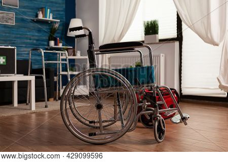 Hospital Medial Wheelchair Standing In Empty Living Room With Nobody In It Ready For Healthcare Ther