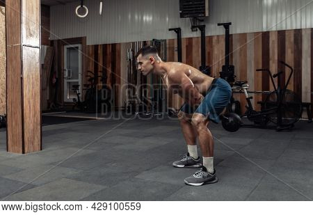 Muscular Powerful Man Exercising With Heavy Kettlebell In Gym. Functional Training With Free Weights