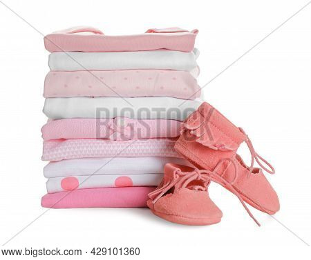 Stack Of Clean Girl's Clothes And Booties On White Background