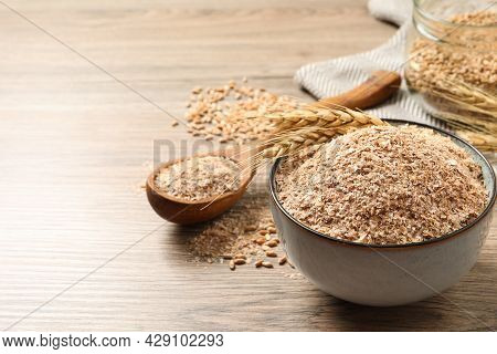 Wheat Bran And Spikelets On Wooden Table. Space For Text