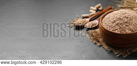 Wheat Bran In Bowl On Black Table. Space For Text