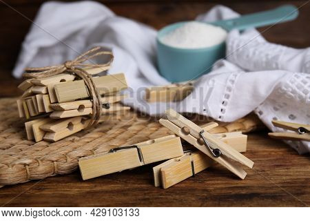 Wooden Clothespins, Scoop Of Laundry Powder And Fabric On Table