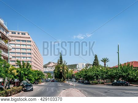Athens, Greece - July 11 2021: View Of Vasileos Alexandrou Ave, With The Divani Caravel Hotel On The