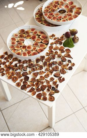 Dried And Fresh Figs Are Laid Out On The Table During The Drying Process