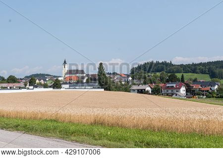 Rural Community Of Putzleinsdorf In A Hilly, Idyllic Landscape In Austria