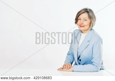 Studio Portrait Of Middle Age Woman Posing On White Background