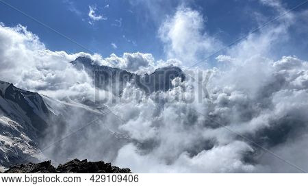 Stunning Views Of The Snow-capped Mountains In White Clouds. Beautiful Landscape Of North Ossetia. C