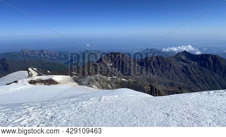 View From The Top Of Mount Kazbek. Hike Across The Caucasus. Mountains, Rocks And Hills. Mountain La