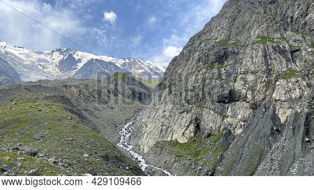 Beautiful Mountain Landscape Of North Ossetia. Snow-capped Mountains, Inaccessible Rocks And Mountai