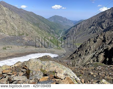 High Mountains, Green Hills And Glacier. Amazing Landscapes Of North Ossetia. Climbing Kazbek From T