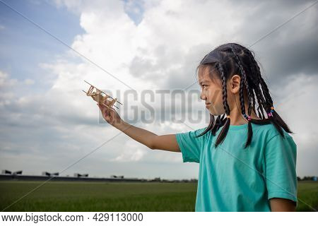 Asian Child Girl With Airplane, Child Playing With Toy Airplane, Happy Kid Playing Outdoors