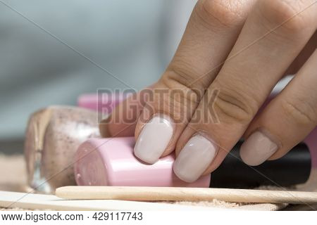 A Woman Does A Manicure At Home. Manicure Tools. Home Care, Spa, Beauty. Nail Salon. Young Woman Mak