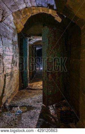 Rusted Metal Armored Door In Old Abandoned Soviet Bunker