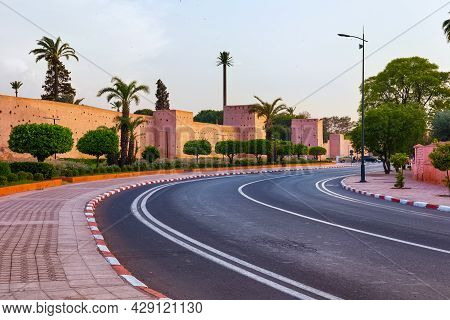 Part Of The Red Medieval Walls Around An Old Historic Area In Marrakech In Evening. Morocco.