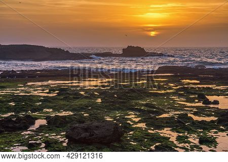 Picturesque Sunset On The Atlantic Ocean In The Area Of Essaouira In Morocco On A Summer Evening In